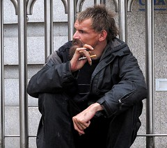 (Don Jackson) Tags: life street portrait people urban hairy man male men face wall beard hands sitting hand arms pavement expression cigarette profile neglected relaxing thoughtful photojournalism documentary atmosphere social gesture railings unshaven global