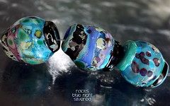 Rocks Blue Night Silvered (Laura Blanck Openstudio) Tags: openstudio openstudiobeads glass handmade lampwork beads set murano fine arts art artist artisan whimsical funky odd rocks faceted nuggets pebbles stones colorful multicolor abstract asymmetric organic earthy raku frit speckles made usa transparent shiny silver silvered leaf black dark blue night lapis turquoise aqua periwinkle lilac lavender purple violet green mermaid teal emerald deep