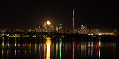 Moon rise over Downtown (biegalskiphotography) Tags: red moon toronto downtown skyscrapers cntower cityscape ontario lake