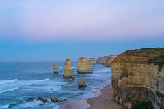 Apostles at dawn (Howard Ferrier) Tags: oceania victoria sunrise purple portcampbellnp southernocean ocean sea waves island dawn stack twelveapostles coast cliff australia landmass time southwest
