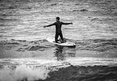 Bring It On (dolbinator1000) Tags: penycwm pembrokeshire wales uk coast coastal sea ocean seaside water summer wave waves wavy boy man surf surfing board arms stretch black white blackandwhite bw blanc noir blancetnoir bn