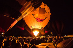 A Face Over the Crowd (djking) Tags: alberta canada heritageinninternationalballoonfestival highriver face female hotairballoons night smile