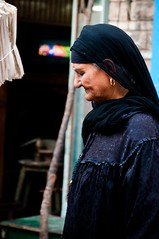 The loaded head (Marwa Morgan) Tags: life africa street old city urban woman smile face lady female contrast nikon colours muslim islam egypt culture documentary cairo arab egyptian oldlady oldwoman muslims residential egitto egypte 2012 afrique  oldcairo resident smilingface d90  lecaire  egyptianpeople  100weshwwesh 100faceandface egyptianfaces 18105mmf3556gii  facesfromegypt