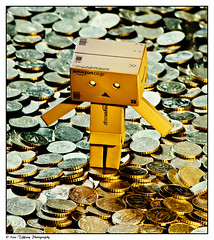 Treasure (danbo) (Lisa Tiffany Photography) Tags: money anime japanese nikon treasure coins cash currency wealth legaltender artisticphotography miura 10cents yotsuba danbo toyphotography creativephotography revoltech hayasaka danboard cardboardboxrobot  d7000 adiscovery mygearandme ringexcellence flickrstruereflection1 rememberthatmomentlevel1