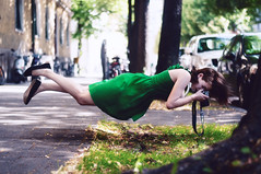 about how cool and easy taking photos is in my imagination (laura zalenga) Tags: street camera woman green nature girl dress levitation europeanflickrchallenge laurazalenga