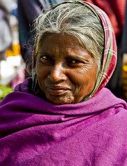 Hello cheeky (rob of rochdale) Tags: poverty woman india flower smile female asian asia purple poor rob age marker vendor merchant kolkata wrinkle robh robhaich