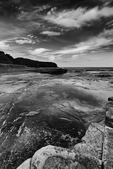 Clarity (Gemma Stiles) Tags: ocean sea bw seascape beach nature water clouds canon landscape coast rocks shoreline australia shore newsouthwales canonefs1022mmf3545usm australiancoast cokinfilters australiancoastline turimettabeach seascapephotography warriewoodbeach pseriesfilters canoneoskissx4