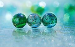 Not Lost (charhedman) Tags: macro water glass reflections bokeh marbles spraybottle