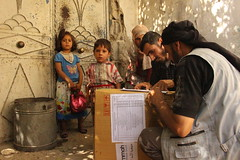 A family in besieged Ghouta assisted with food provisions (Ummah Welfare Trust) Tags: syria food ramadan ramadhan islam muslims سوريا سورية poverty aid children war refugee displaced hunger humanitarian humanitarianism