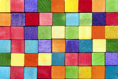Colorful background texture of wooden blocks (gtaunt) Tags: rainbow spectrum colors arrangement background blocks colorful cubes fullframe lines rows toy vibrant wooden pattern