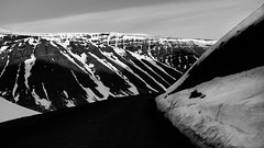 driving through almost abstract landscapes (lunaryuna) Tags: iceland northwesticeland westfjords landscape road passroad landscapeabstract linesandshapes lateafternoonsun lightshadow chiaroscuro naturalabstract ontheroad mountainrange lunaryuna blackmwhite bw monochrome