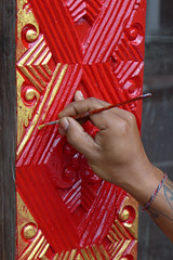 Passion For Detail (TablinumCarlson) Tags: indonesia indonesien bali tr door leica dlux 6 asien asia entry eingang architektur temple tempel venerable ehrwrdig alt old ubud hand maler artist knstler red rot handwerk gold painter passion detail passionfordetail tatoo man armband mann