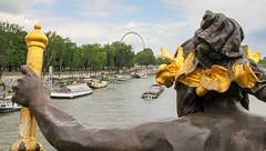 Nymph With Good View of Grand Carousel, Place de la concorde (bygeorge) Tags: france paris pontalexandreiii parisbridges seine nymphs carrousel