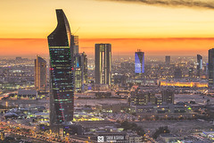 Kuwait - Golden Hour Sunset With Altijariya Tower (Sarah Al-Sayegh Photography   www.salsayegh.com) Tags: kuwaitcity kuwait canoneos5dmarkiii winter clouds canon leefilters sunset cityscape skyline hazy weather skyscrapers wwwsalsayeghcom infosalsayeghcom sarahhalsayeghphotography photography cityscapephotography leefilter