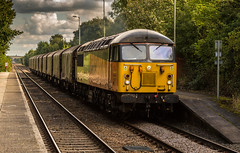 Colas Railfreight Class 56/0 no 56113 passes through Elton & Orston Station on 23-09-2016 with the Boston to Washwood Heath empty steel. (kevaruka) Tags: elton orston leicestershire station autumn 2016 september colour colours colas rail freight train dmu countryside east midlands nottinghamshire trains transport railway network british class 60 56 england yellow orange flickr front page thephotographyblog ilobsterit stock canon eos 5d mk3 ef100400 f4556l 5d3 5diii composition locomotive heritage historic lines leading rule thirds boobs milf sexy wife scenic scenery trees green 56113 railroad vehicle outdoor