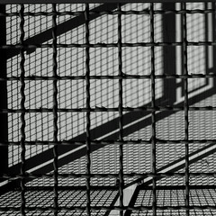Caged light B&W (sandroraffini) Tags: abstract reality mind landscapes cages light shadow bw urban details supermarket psicogeografia exploration patterns interference interferenza fotoni matrix matrici square environment sandroraffini bologna angst newtopographics geometry geometria optical blunt stark