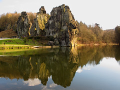 Reflected Rocks (Batikart) Tags: travel blue vacation sky people sun sunlight lake holiday reflection tree green monument nature water rock clouds stairs canon germany bench landscape geotagged deutschland see spring sa