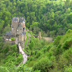 Burg Eltz nestled in the green hills above the Moselle River (Bn) Tags: wood old trip family vacation green castle history castles nature beautiful stone fairytale century forest wonderful germany landscape geotagged deutschland spring topf50 solitude zoom hiking engineering visit disney medieval eifel valley historical imagination hd charming middle residence dreamlike 9th schloss topf100 fortress allemagne ages middleages burg mosel discover kasteel unchanged rheinlandpfalz schlsser moyenge eltz mittelalter burcht karden burgen sprookjes mnstermaifeld eltzcastle moezel wierschem moselkern cindarellacastle 100faves 50faves elzbach holidaysvacanzeurlaub burgenundschlsser grafvoneltz geo:lon=7336571 geo:lat=50204896