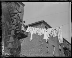 Wet washes and chimneys (Boston Public Library) Tags: clotheslines dwellings architecturaldetails lesliejones