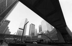 Tokyo Metropolitan Government Building and Shinjuku Skyscrapers (huzu1959) Tags: street building film architecture analog canon tokyo vanishingpoint shinjuku asia wide   neopan fd canonf1    gettyimagesjapan12q2
