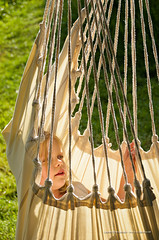 Young girl in a hammock with lights and shadows (LaurentBrancaleoni) Tags: light shadow girl garden hair children nikon child portait jardin vert blond blonde hammoc enfants enfant portaits fille lumières verdure herbe ombres corde fillette hamac ombresetlumières ombreetlumiere d7000