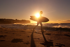 Bronte Surfer (Kokkai Ng) Tags: morning shadow sea sky sun sunlight man men beach water silhouette sport yellow sunrise beard dawn one twilight sand energy waves purple angle surfer low sydney sunny australia running run surfing surfboard passion newsouthwales backlit jogging excitement wetsuit oneperson bronte clearsky caucasian watersport sydneyaustralia exercising brontebeach