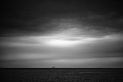 Transition (absencesix) Tags: ocean travel summer sky bw usa seascape nature rain weather june ferry clouds dark boats washington marine moody seasons unitedstates infinity 85mm noflash ii transportation mysterious northamerica pugetsound lonely anacortes simple minimalist locations 2012 locale 85mmf14 tonality iso1100 geo:state=washington exif:focal_length=85mm anacorteswashingtonusa apertureprioritymode hasmetastyletag hascameratype adjectivesfeelingdescription haslenstype camera:make=nikoncorporation 1400secatf14 selfrating5stars exif:iso_speed=1100 exif:make=nikoncorporation exif:lens=850mmf14 geo:countrys=usa exif:aperture=14 subjectdistanceunknown afsnikkor85mmf14g nikond800e 2012travel exif:model=nikond800e camera:model=nikond800e june172012 orcasisland0617201206182012 geo:lon=122710314 geo:lat=48521008 geo:city=anacortes 483116n1224237w