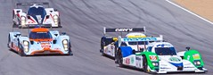 Close racing toward turn 2 (Steve Slaback) Tags: race lola tires laguna lagunaseca turn2 racecars alms mazdaraceway oreca lagunasecaraceway amercianlemansseries raceintothedarkness
