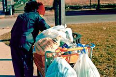 Overlooked (IM_1251) Tags: street red people orange grass hat boston trash bag walking walk massachusetts homeless shoppingcart jfk jacket recycle recycling dorchester umass trashbag trashbags