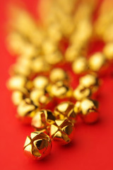 Jingle Bells (JebbiePix) Tags: red blur macro metal closeup bells gold pentax bokeh small tiny jinglebells zykkor
