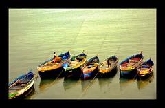 Fishing boats (arun.ragh) Tags: morning travel sea vacation india water colors boat fishing nikon south 16mm d90
