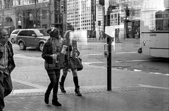 they say that the world was built for two (Super G) Tags: street city urban blackandwhite bw woman man film walking 50mm doubleexposure streetphotography nikonn80 fujineopan400 selfdeveloped d7695mins68d11