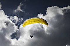 Paraglider (Daniel Wildi Photography) Tags: blue sky yellow clouds paragliding approach paraglider interlaken 2012 lehn landingplace danielwildiphotography