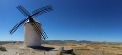 Where the Wind Wanders (Carlos Gotay Martnez) Tags: sky landscape nature light outdoor outside texture history hills dry drought arid terrain dryland travel spain windmills consuegra donquijote castilla traveldestination donquixote lamancha landmark panorama breeze wind openspace