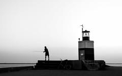 Fisherman (jack.swinkels) Tags: fisherman fishing lighthouse sunset bw blackwhite blackandwhite contrast sea ocean ijmuiden netherlands holland mar noir noiretblanc
