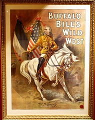 French poster used by the Wild West Show in 1905.  Exhibit at the Buffalo Bill Museum on Lookout Mountain, Colorado (lhboudreau) Tags: buffalobill buffalobillmuseum museum lookoutmountain colorado usa williamfcody williamfbuffalobillcody cody buffalobillcody scout buckskins horse whitehorse isham poster cowboyhat exhibit armyscout boots saddle leather americanflag wildwest buffalobillswildwest frenchposter horseback artwork adrianjones wildwestshow buffalobillswildwestshow frame pictureframe