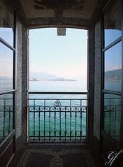 Door to Heaven (gentle flower) Tags: italy lagomaggiore isolabella see norditalien wasser fenster blick blau gelnder