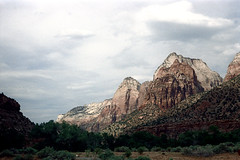 34-216 (ndpa / s. lundeen, archivist) Tags: nick dewolf nickdewolf color photographbynickdewolf 1970s 1973 film 35mm 34 reel34 utah southwestutah southwesternunitedstates zionnationalpark nationalpark mountain mountains sky clouds peak peaks rocks rocky outcropping landscape rock crag