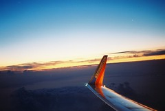 183700-R1-15-16A (planktons) Tags: blue sky cloud sunlight film clouds plane sunrise 35mm airplane horizon aeroplane aerial lousiana gradient