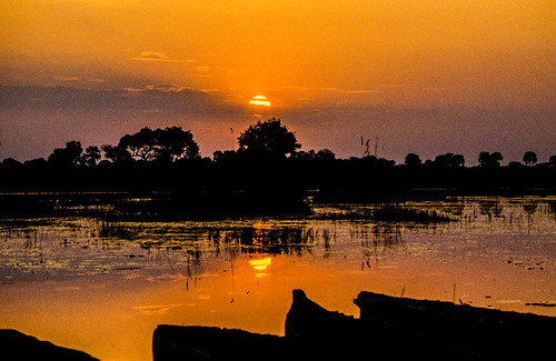 Sunset with boats in Okawango