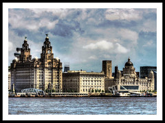 Three Graces (Tonemapped) (Stephen Whittaker) Tags: city blue sky people lighthouse building bird tower art water sunshine rock port liverpool radio river cafe nikon northwest fort sunny threegraces perch liver cunard hdr mersey listed newbrighton merseyside photomatix tonemapped d5100 arethesebuildings whitto27