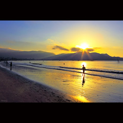 Walking in sunlight [ EXPLORED ] (-clicking-) Tags: ocean sea sky people sunlight mountain seascape reflection beach nature water sunshine silhouette sunrise walking dawn golden onthebeach waves natural vietnam rays brilliant raysofsunlight bìnhminh quynhơn