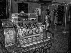 Who seen one of this working? (Vitor Pina) Tags: street streetphotography streets scenes shadows candid contrast cidade city monochrome momentos moments mulher woman photography pretoebranco people pessoas urban urbano rua reflection window