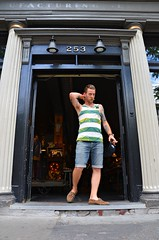 253 Queen Street West (Pedestrian Photographer) Tags: dsc5875b dsc5875 253 hipster man dude guy striped t shirt tank top queen st street west toronto lavish squalor arms shorts denim door entrance july 2016 ribbet hip tat tats tattoos customer leaving exit exiting