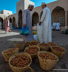 Dates seller (Sreelesh Sreedhar) Tags: culture wideangle outdoor ngc heritage human nikon nikonflickraward nikond800 muscat nikon1635mm oman omani specialmoment mosque dates eidday