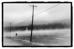 New England mysteries, USA 1990 (Juha Riissanen) Tags: usa bw field man mist church snow telephonepoles mystery newengland