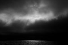 Day or Night? (Mikael R.) Tags: sky cloud cloudporn blackandwhite bw landscape cloudscape sea water sun reflection island archipelago finland pargas nikond7000 sigma1750mm28 light day nature night landskap hav himmel moln sol ljus dag natt  skrgrd