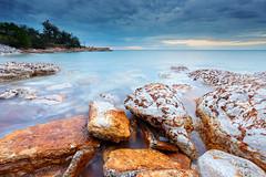 Nightcliff Rocks under cloud (Louise Denton) Tags: nightcliff darwin nt northernterritory australia sea ocean water longexposure cloud overcast rocks moody blue redrocks red yellow flecks porcelinite cliffs outback