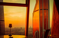 1823-1 (i.gorshkov) Tags: urban travel architecture moscow city skyscraper sunset sun sky clouds orange horizon beautiful view hotel room indoor outdoor business dawn evening building cityscape blue