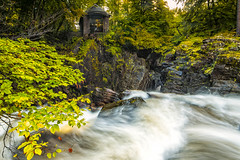 Autumn Folly (JSP92) Tags: scotland unitedkingdom gb ossians hall folly autumn colours leaves trees woods yellow gold green water waterfall river braan rocks le long exposure nd grad polariser lee filter nikon